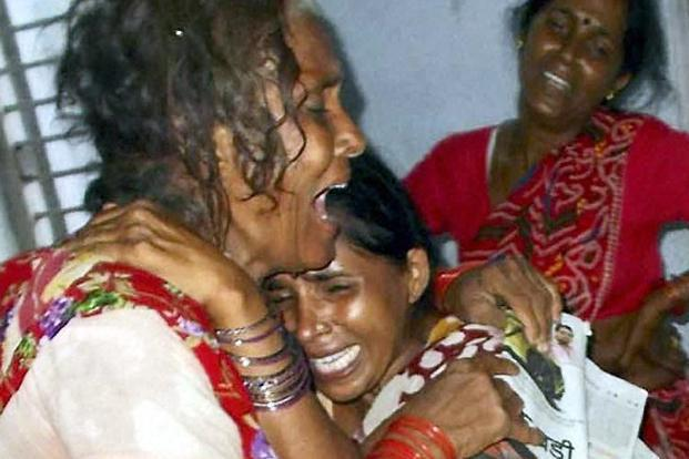 Relatives of one of the dead school children. The scheme was introduced by the then Tamil Nadu chief minister K. Kamaraj in the 1960s and has been adopted by most Indian states after the Supreme Court's directive on 28 November 2001. PTI
