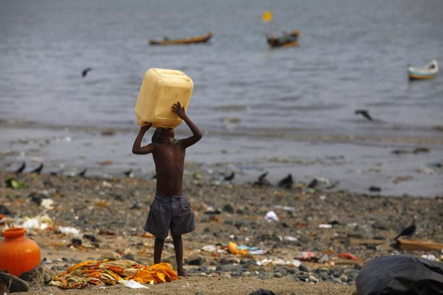 A child drinks water on a beach in Mumbai. A significant portion of diseases caused by poor water supply, sanitation and hygiene, affect children younger than five, the report said. It attributed 23% of child mortality in the country to environmental degradation. Reuters