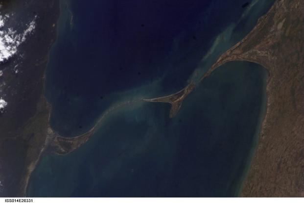 In the absence of a continuous navigational channel, the international shipping route circumnavigates Sri Lanka due to the presence of a reef, known as Adam's Bridge (pictured), located southeast of Rameswaram near Pamban in Tamil Nadu. Photo: NASA