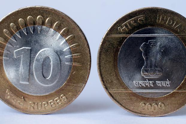The local currency, which opened at 59.72, tested a low of 59.87 in the first half. Photo: Ramesh Pathania/Mint