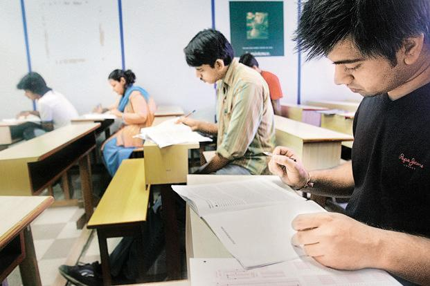 The Institute of Banking Personnel Selection (IBPS) conducts the common written test for 20 state-owned banks (excluding State bank of India and associate banks) and Export Credit Guarantee Corp. of India Ltd for recruitment of probationary officers and clerks. Candidates are assigned a score that is valid for one year from the date of the examination.  Photo: HT