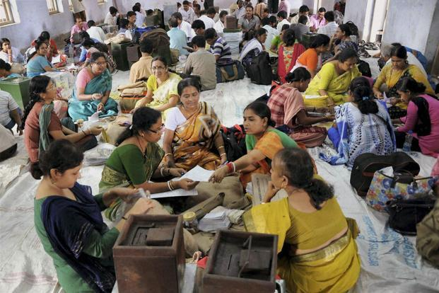 A file photo of women polling officials checking panchayat polls ballot papers at a distribution center in Nadia district of West Bengal on Sunday. Photo: PTI
