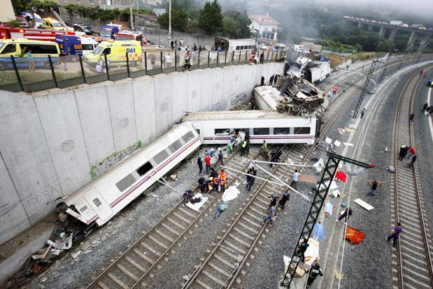 A picture shows derailed cars at the site of a train accident near the city of Santiago de Compostela. The train which carried 238 passengers originated in Madrid and was bound for the northwestern town of Ferrol. Photo: AFP