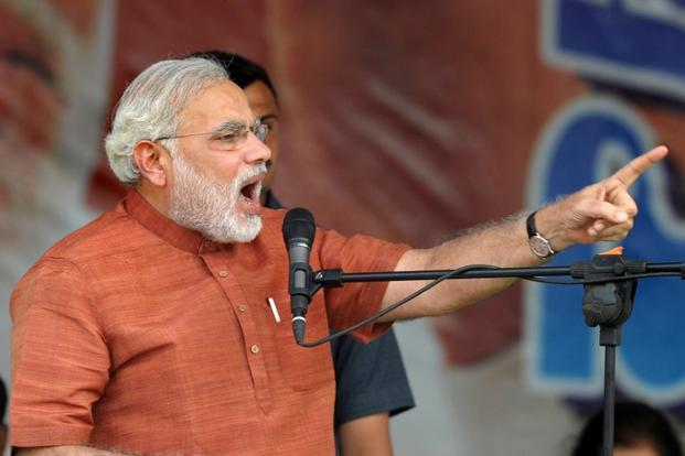 "In a letter dated 7 August, Narendra Modi said that poor families have been made 'food insecure' through the ordinance which ""does not fulfil the basic objectives of food security"".  Photo: AFP"