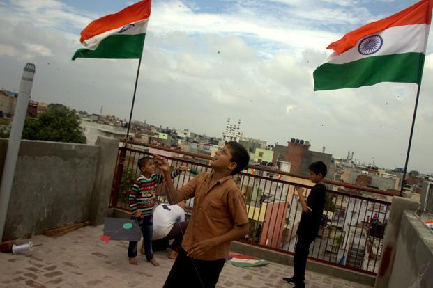 Kite flying and kite battles are an Independence Day tradition in Delhi. The normally packed roads of the Old Delhi remain empty as people crowd their roof-tops to fly kites and engage in animated battles. Photographs: Pooja Chaturvedi/Mint