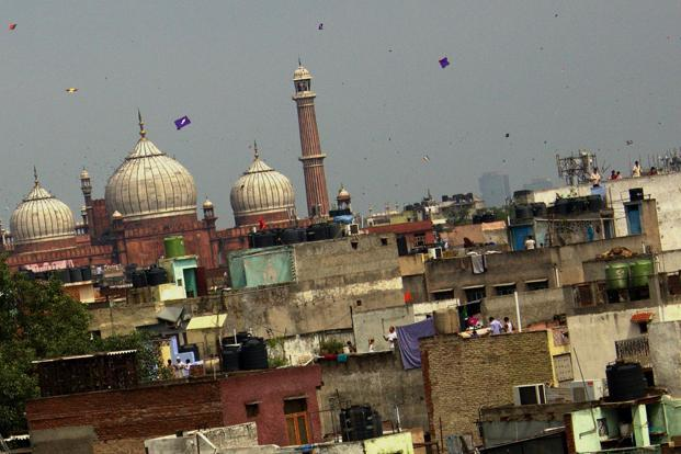 Kites soar against the background of the majestic Jama Masjid. This is one time when the old, the young, men, women and children participate enthusiastically in the sport.