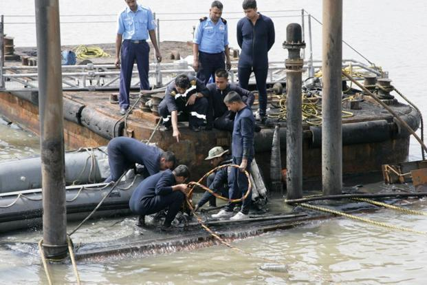 A file photo of Indian Navy divers and personnel conning tower of the stricken INS Sindhurakshak, after the submarine sank following an explosion at the naval dockyard in Mumbai. Photo:  AFP/Ministry of defence