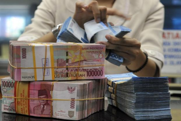 The rupiah slid 1% to 10,490 per dollar in Jakarta, the biggest drop since 23 July, according to prices from local banks. Photo: AFP