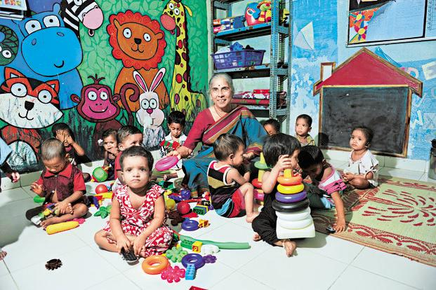 Armida Fernandez sits along with kids in one of SNEHA's nutrition day care centres in Dharavi, Mumbai. Fernandez has set up SNEHA, an NGO, which works in the field of maternal and infant health, prevention of violence against women and children, and health and nutrition. Photo: S. Kumar/Mint (S. Kumar/Mint)