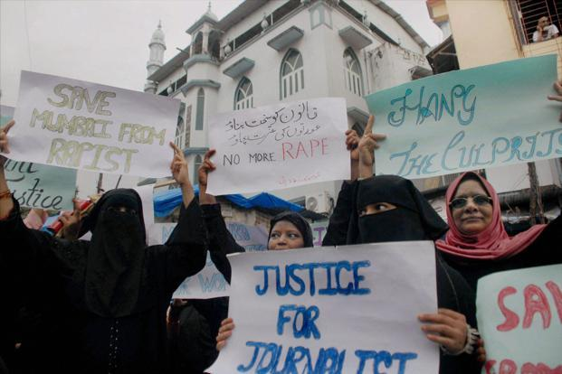 Muslim women protest against gang-rape of a photojournalist in Mumbai on Monday. PTI Photo<br />