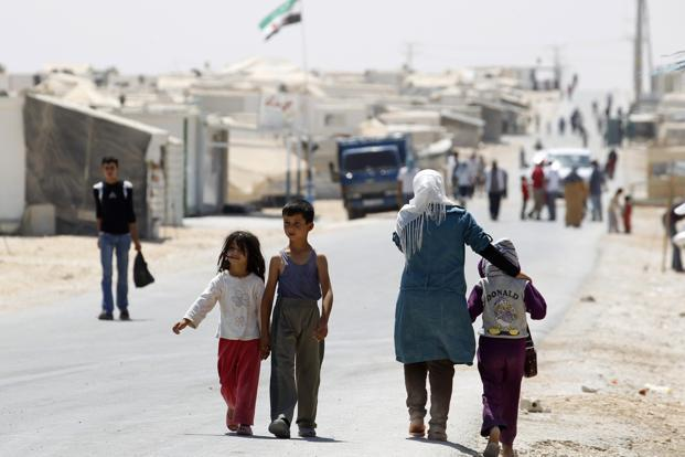 Syrian refugees walk at Al-Zaatri refugee camp in the Jordanian city of Mafraq, near the border with Syria. Photo: Reuters (Reuters)