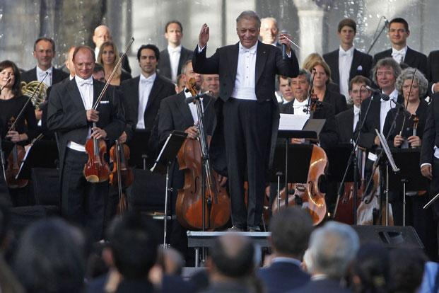 Bavarian State Orchestra and renowned conductor Zubin Mehta (centre) gestures before performing at the Ehasas-e-Kashmir concert at Shalimar Garden on the outskirts of Srinagar. Photo: Reuters