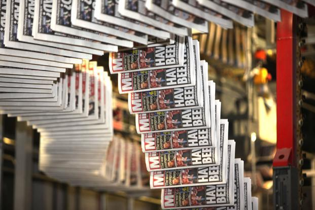 Copies of the Daily Mirror newspaper at the production line at Trinity Mirror's factory in Watford, UK. Photo:Bloomberg