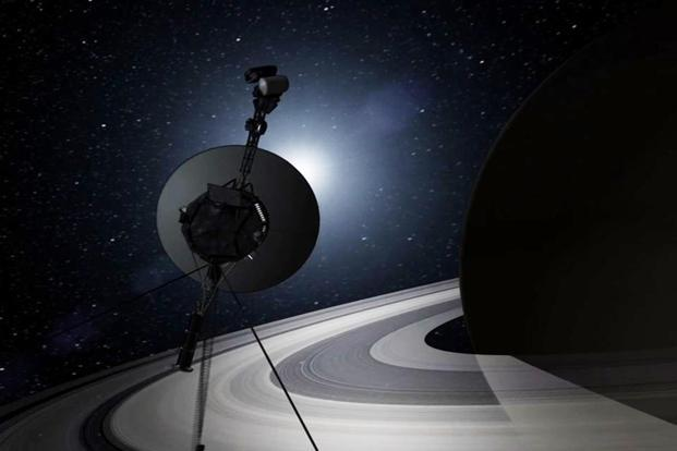 This artist's concept shows Voyager encountering Saturn en tour the solar system. The amount of power available to the probe has decreased over time, and will no longer be able to power any single instrument by 2025, reports say. Reuters