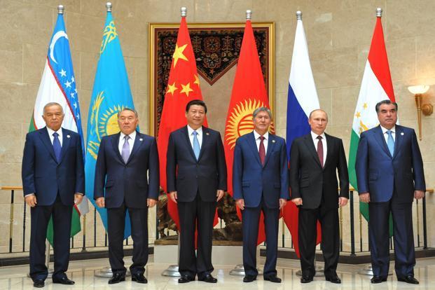 (From right) Tajikistan's President Emomali Rakhmon, Russia's President Vladimir Putin, Kyrgyzstan's President Almazbek Atambayev, China's President Xi Jinping, Kazakhstan's President Nursultan Nazarbayev and Uzbekistan's President Islam Karimov pose for a photo during a summit of the Shanghai Cooperation Organization in Bishkek, on Friday. Photo: Vyacheslav Oseledko/AFP  (Vyacheslav Oseledko/AFP )