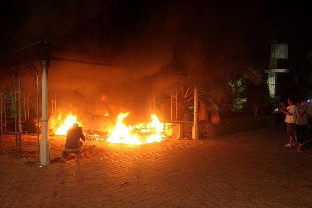 A file photo shows a vehicle and the surrounding area engulfed in flames after it was set on fire inside the US mission compound in Benghazi. Photo: AFP (AFP)