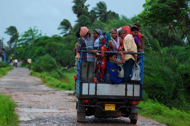 Evacuees leave their village for a safer place in Sanabandha village near Gopalpur in Odisha. Photo: Asit Kumar/AFP