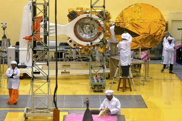 Scientists at the Isro centre in Bangalore. The spacecraft will move to an elliptical orbit around Earth for around 25 days before leaving on 30 November for a 300-day journey to Mars. Rocket PSLV C25 is the launch vehicle and is about 44.4m tall. AFP