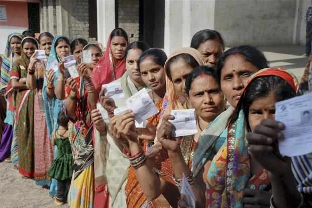 People queue outside the polling booth for casting their vote in the assembly election 2013 in Raipur on Tuesday. Photo: PTI