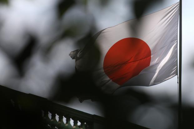Japan's economic growth halved year-on-year in the July-September quarter as exports weakened and consumer spending slowed, showed official data. Photo: Bloomberg