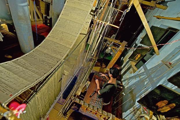 16-year-old Mogeez working on a pit loom. Photographs by Priyanka Parashar/Mint