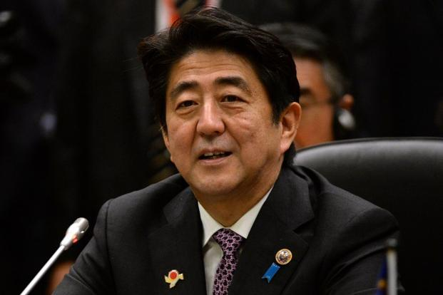 To revive an economy that's averaged 0.6% growth in the past 15 years, Shinzo Abe announced a 10.3 trillion-yen spending boost in January.  Photo: Roslan Rahman/AFP