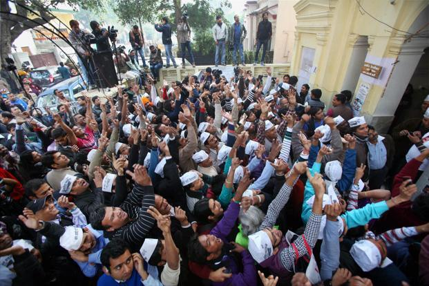 Aam Aadmi Party (AAP) supporters celebrate the party's excellent show in Delhi assembly elections on Sunday. Photo: PTI