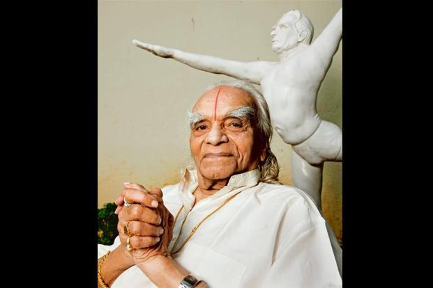 BKS Iyengar at his institute in Pune with a statue of his young self at the background. Photo: Namas Bhojani for SZ magazine