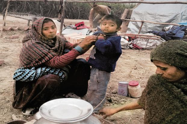 Salima and her family set up camp at Neem Kheri bus station after being evicted from Loi camp. Photo: Namita Bhandare