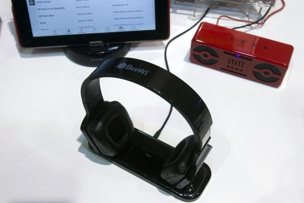 BeeWi BBH300 headphones on display. The headphones stream music from a smartphone or MP3 player but can also forward the music to a stereo when attached to a docking station. Reuters