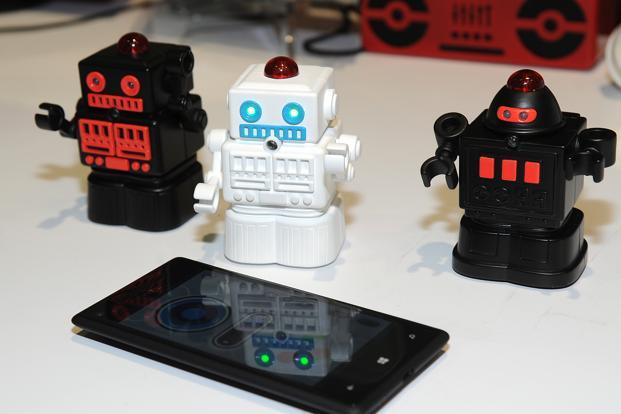 "BeeWi's Bluetooth fighting mini robots connect via Bluetooth and pack infrared ""guns"" inside their eyes. They're operated by an app and can be moved with motion control, by tilting and turning a mobile device. AFP"