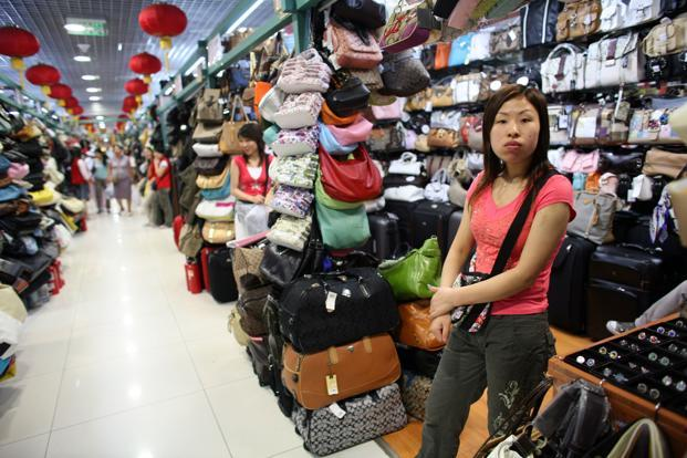 A file photo of a vendor selling fake handbags at the Silk Market in Beijing. Photo: Natalie Behring/Bloomberg