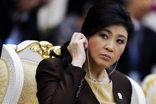 Protesters, who want Yingluck Shinawatra to step down to make way for an unelected 'people's council' to oversee reforms, have occupied key govt buildings and forced Yingluck to work from undisclosed locations around the capital. Photo: Reuters