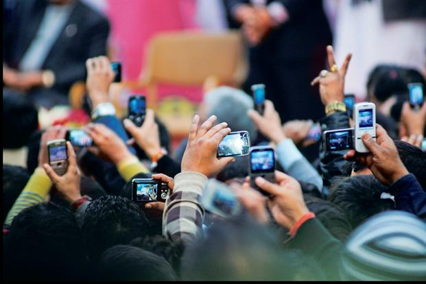 Today, nearly 130 million Indians use their mobiles to get onto the Internet. Photo: Pradeep Gaur/Mint
