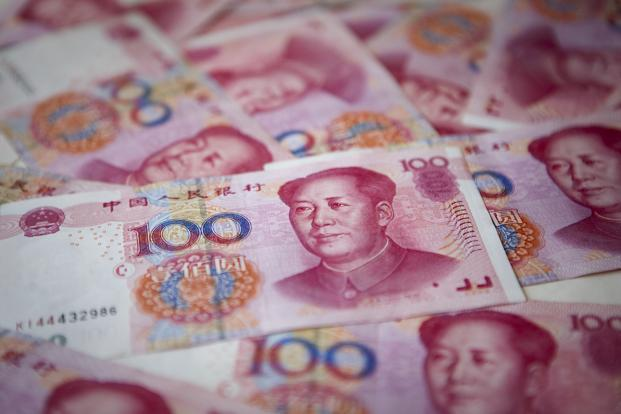 The offshore yuan fell 1% to 6.0933 per dollar last week, a decline unseen since September 2011. Photo: Bloomberg