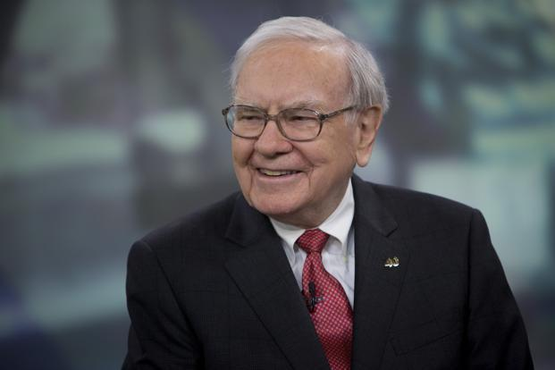 Warren Buffett has pursued a buy-and-hold investment approach as he built Berkshire into a $280 billion company accumulating the largest holdings of Coca-Cola, American Express and Wells Fargo and Co. Photo: Bloomberg