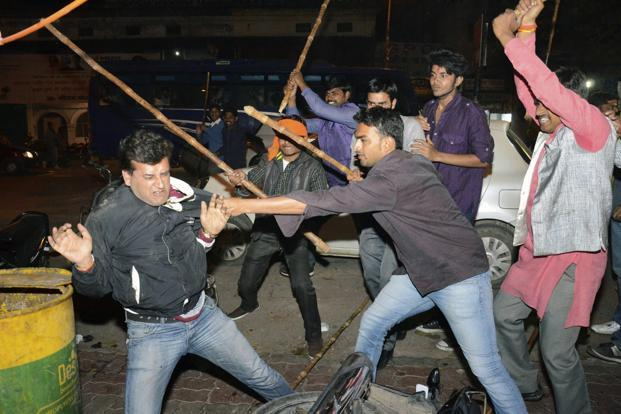Reuters; BJP supporters clash with AAP supporters in Lucknow. The clashes snowballed after AAP workers protested