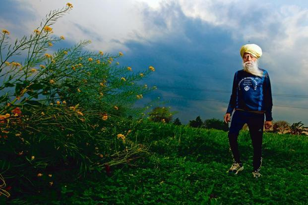 Fauja Singh heads out for his daily run in his village near Jalandhar. Photo: Priyanka Parashar/Mint