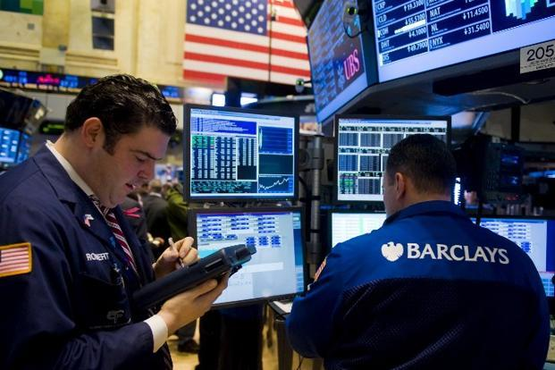 Bullish investors have justified the rally in the US equity market citing improvement in companies' earnings in the light of a recovering economy. Photo: AFP
