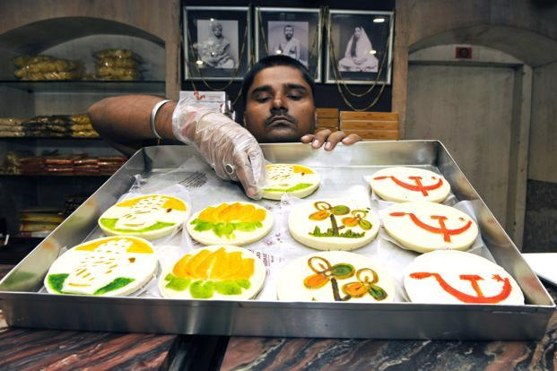 A worker arranges the 'Nirbachani Sandesh' (Election Sandesh) embossed with symbols of