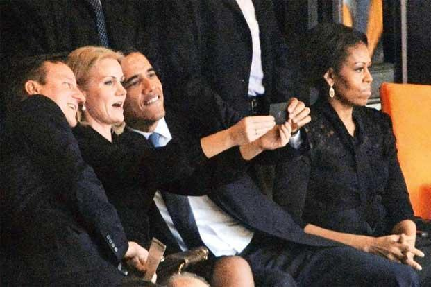Strike out: (from left) British Prime Minister David Cameron, Danish Prime Minister Helle Thorning-Schmidt and US President Barack Obama pose for a selfie, sitting next to US First Lady Michelle Obama, during the memorial service for South Africa's former president, Nelson Mandela, on 10 December. Photo: Roberto Schmidt/AFP