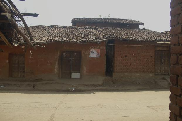 Campaign posters and signs on the walls of locked homes of migrants in Balangir's Tentulimunda village. Photo: Chitrangada Choudhury Aga