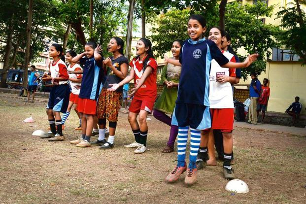 Girls from Team Leher, including Kavita (centre, in red jersey), Mamta (right, red shorts) and Ujwala (right, in blue jersey) practise at a public ground. Photographs by Abhijit Bhatlekar/Mint