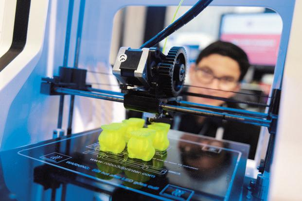 A Gartner report had forecast worldwide shipments of 3D printers, priced at less than $100,000 (around <span class='WebRupee'>Rs.</span>60 lakh), to grow 49% in 2013 to total 56,507 units. Photo: AFP