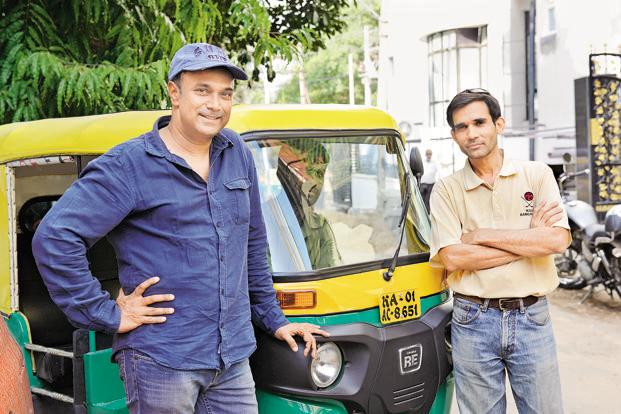 The founders of mGaadi, Solomon Prakash (left) and Vishy Kuruganti. Though the application has about 2,157 enrolled autorickshaw drivers, the entrepreneurs plan to hit 20,000 enrolments by the end of the year.  Photo: Hemant Mishra/Mint