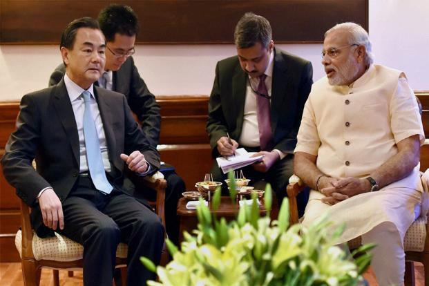Prime Minister Narendra Modi (right) with Chinese foreign minister Wang Yi at a meeting at 7 RCR in New Delhi on Monday. Photo: PTI