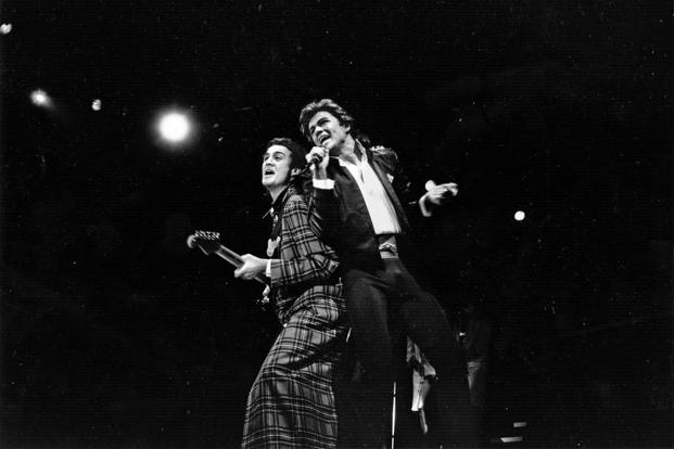 George Michael (right) and Andrew Ridgeley of Wham! during a live performance. Photo: Express Newspapers/Getty Images