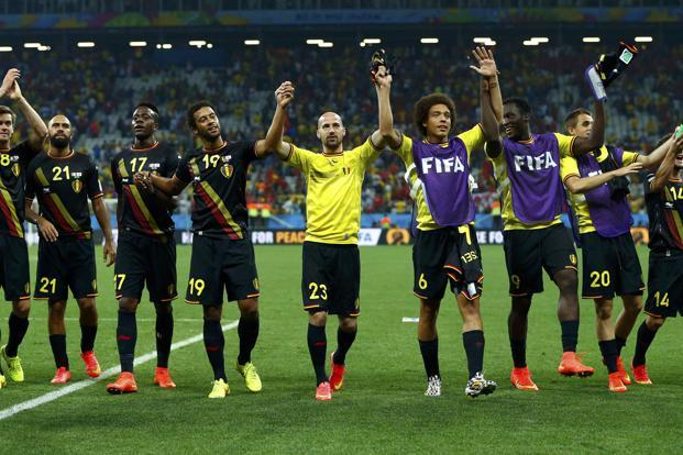 The Belgium team celebrate their World Cup 2014 Group H 1-0 win against South Korea on Thursday. Photo: Reuters