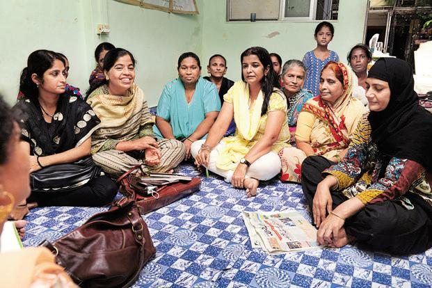 Niaz (in yellow), one of BMMA's founders, with other members at their office in Mumbai. BMMA is one of the increasingly vocal Muslim women's rights groups that have come up in recent years. Photo: Abhijit Bhatlekar/Mint