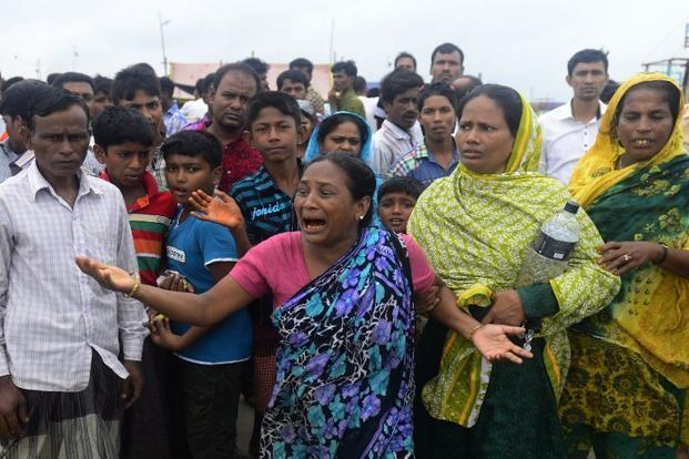 Photo of Relatives of those missing after the ferry capsized in Munshiganj. Photo: AFP